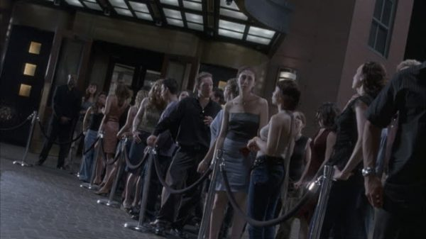 PEOPLE STANDING IN LINE WAITING TO ENTER A NIGHTCLUB OR BAR IN LAS VEGAS